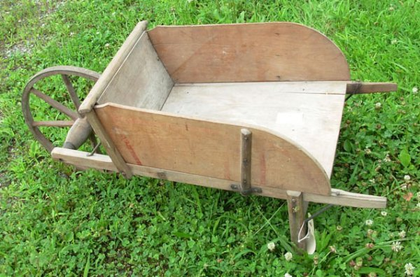 1016: Child's wheel barrow with wooden wheel