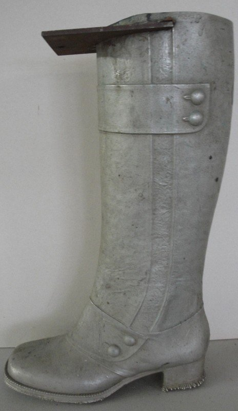 "7: Old iron boot mold. 18""H."