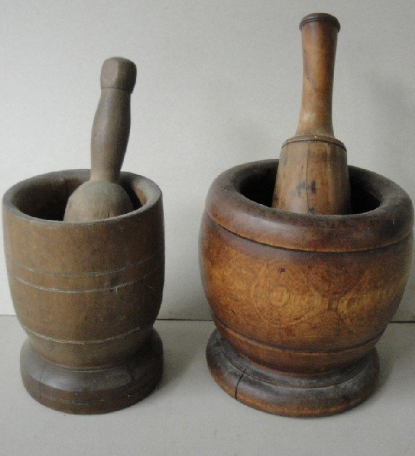 22: Two early mortar and pestles.