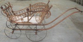 15: Victorian Wicker doll carriage.