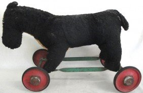 18: Stuffed dog on wheels.