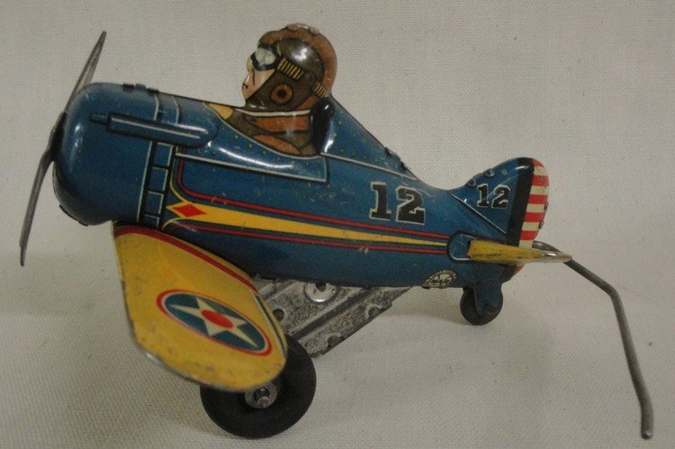 181: Two windup tin toys inc. Marx No. 7 race car and N