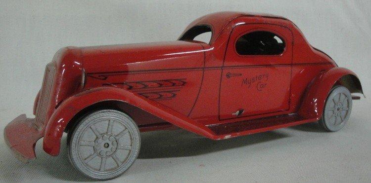 """183: Tin automobile entitled """"Mystery Car"""" - 13"""" length"""