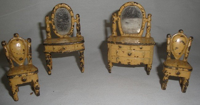 188: Four pieces of cast iron Victorian doll furniture
