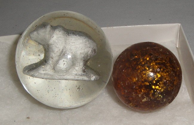 190: Two marbles inc. one celluloid with bear insert