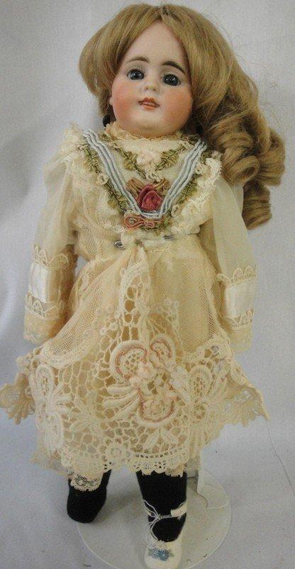 168: European doll - porcelain head with fixed blue eye