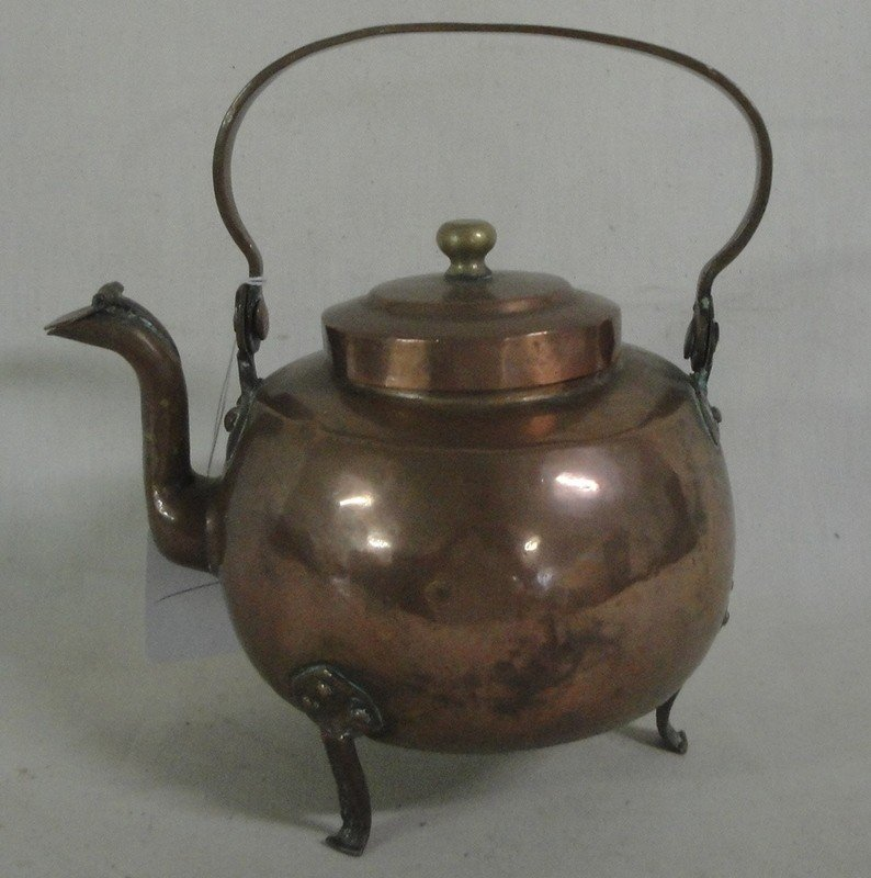 512: Hand-hammered copper tea kettle on feet - swivel h