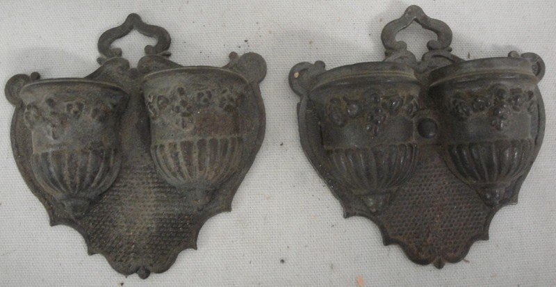 516: Two cast iron match holders - one signed on revers