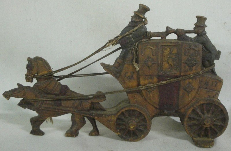 521: Cast iron coach, horse and rider doorstop