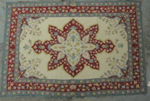 7: Woven antique oriental  rug with floral medallion