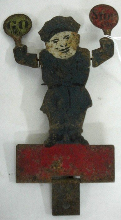 46: Early hand-painted tin shooting target of policeman