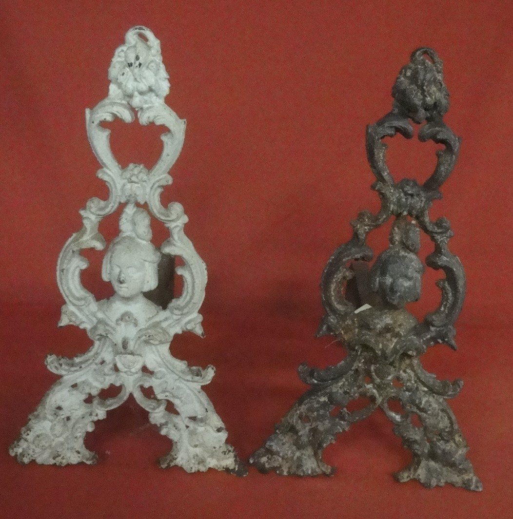 13: Pair of ornate cast iron andirons with Jenny Lind f