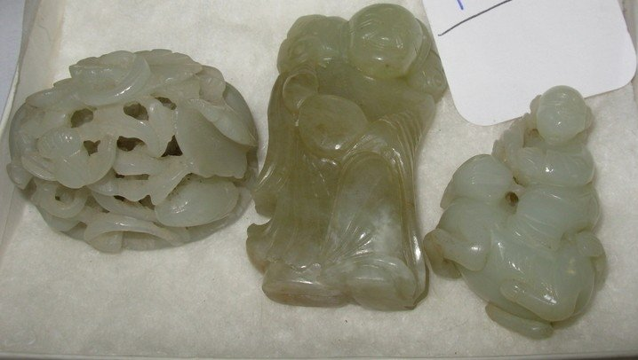 121: Three ornate hand-carved jade Japanese netsukes ?