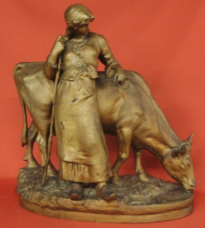 200: Gilded zinc casting of young woman and cow signed