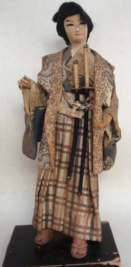 208: Old oriental doll in original costume with samuri