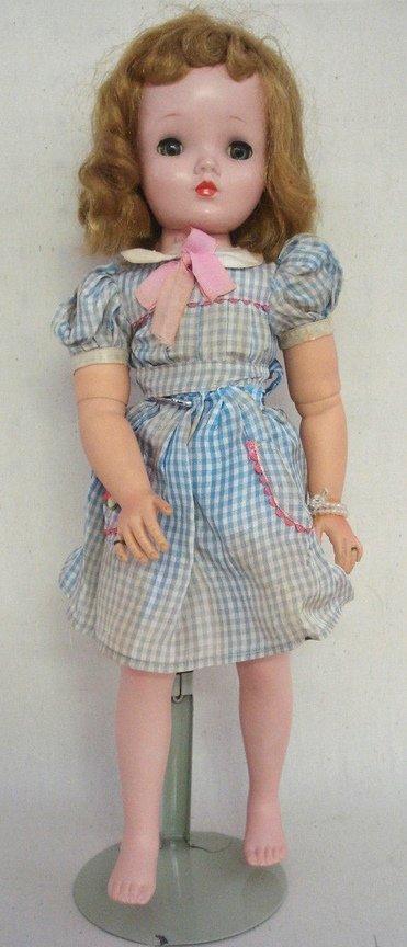210: Madame Alexander vinyl and plastic Maggie Face dol