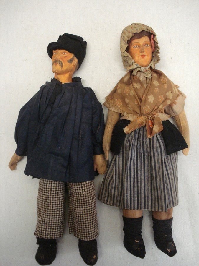 217: Two folk art dolls of man and woman, each with mol