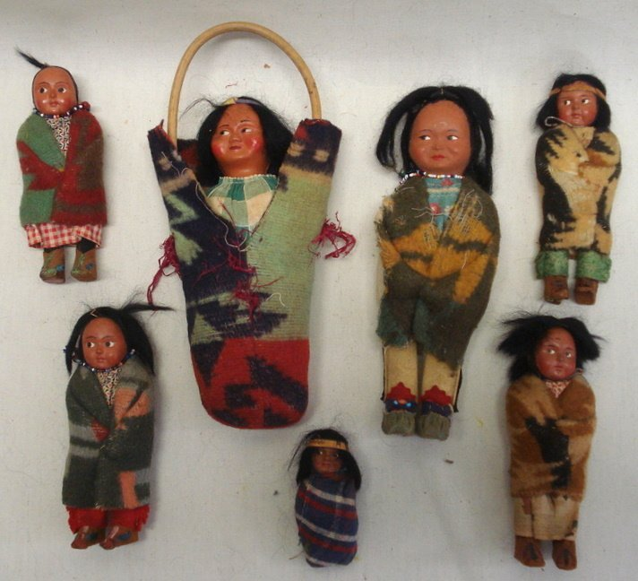 """220: Seven small Skookum dolls including 9"""" doll with h"""