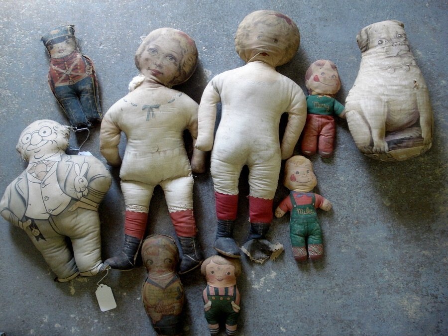 222: Collection of 8 old cloth dolls, some in need or r