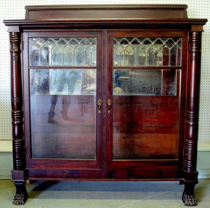 301: Massive mahogany double door bookcase with leaded