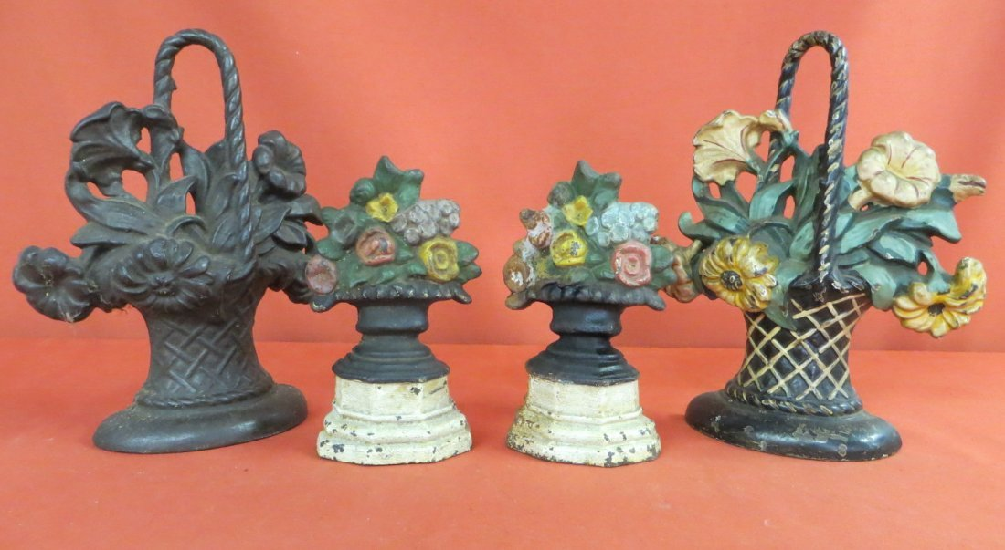 2: Four cast iron flower basket doorstops