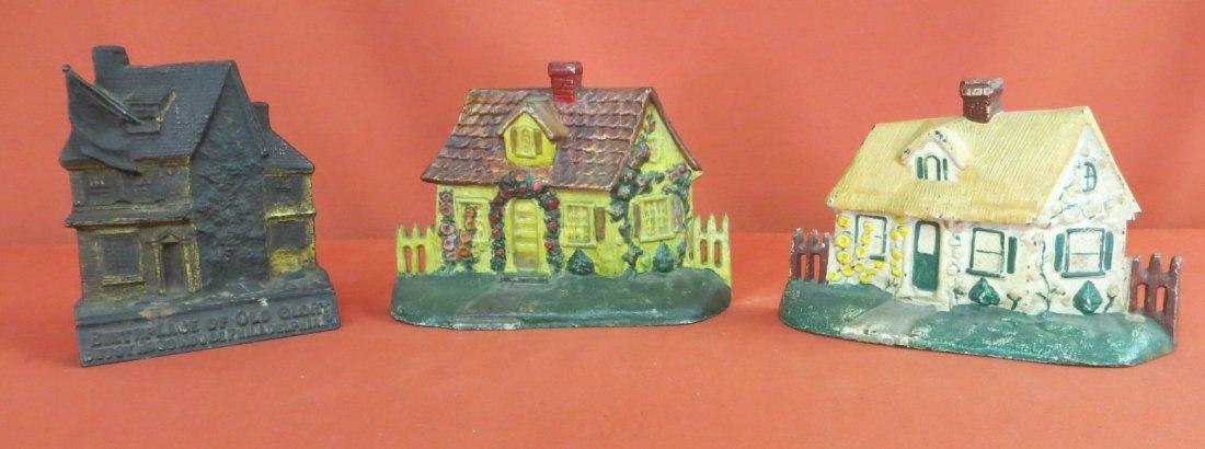 4: Three Cast Iron cottage style door stops.