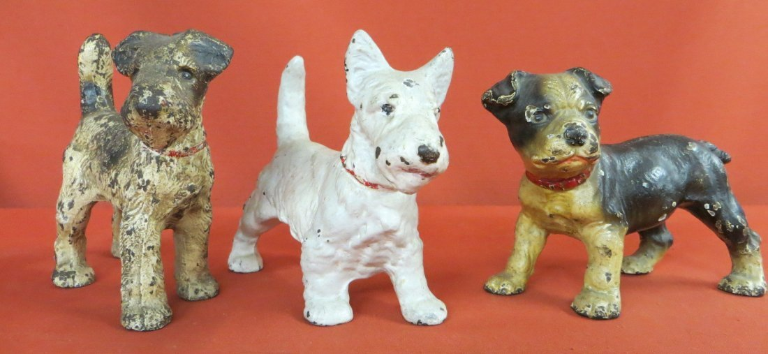 5: Three solid cast iron dog door stops each measuring