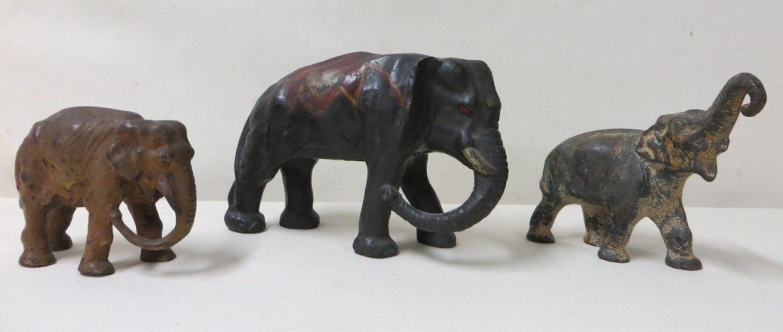 7: Three cast iron elephant door stops in old paint. Si
