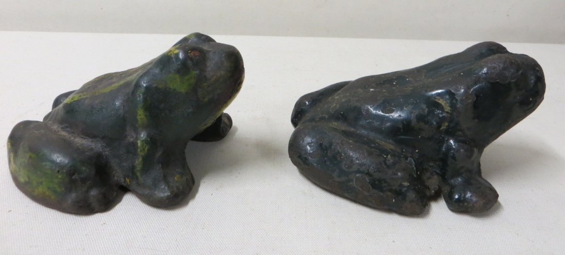 10: Two cast iron frog door stops, both in old green pa