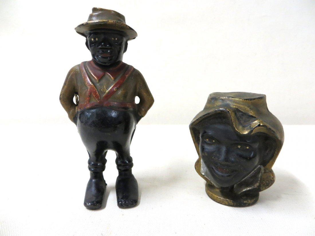 13: Two cast iron Black Americana still  banks includin