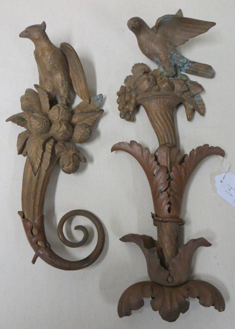 14: Two non-matching brass finials each with a bird per