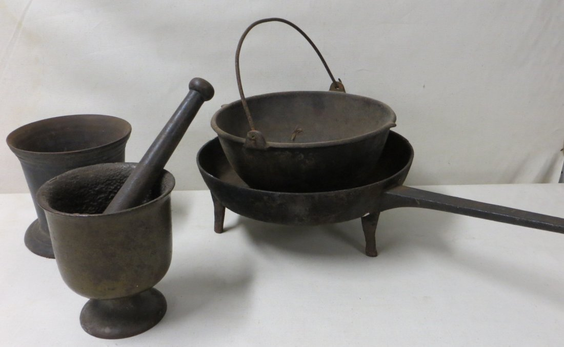 19: Five pieces of early cast iron.