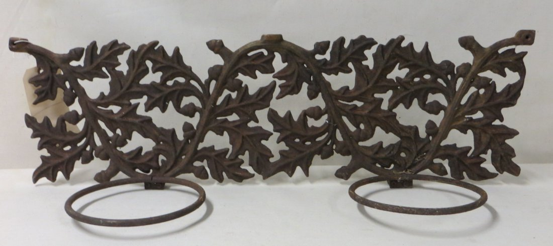 21: Two cast iron double font plant holders, one with a