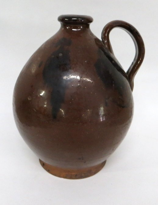 184D: Redware ovoid jug with manganese decoration.