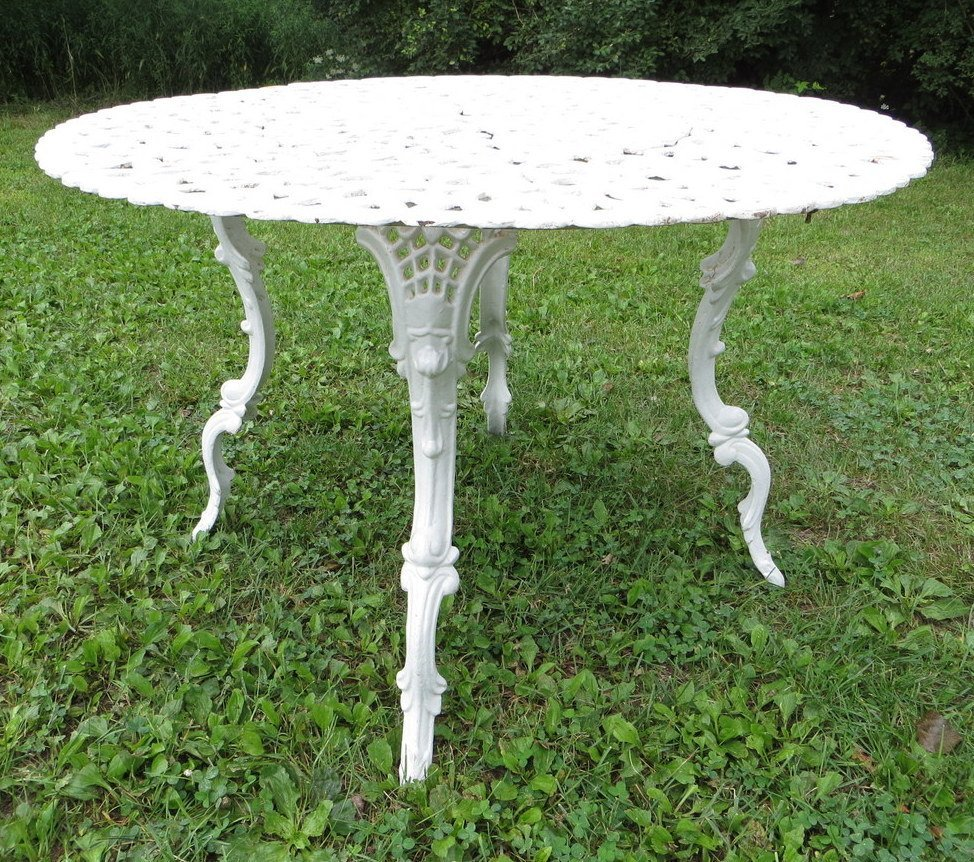 4: Round cast iron garden table with ornate reticulated
