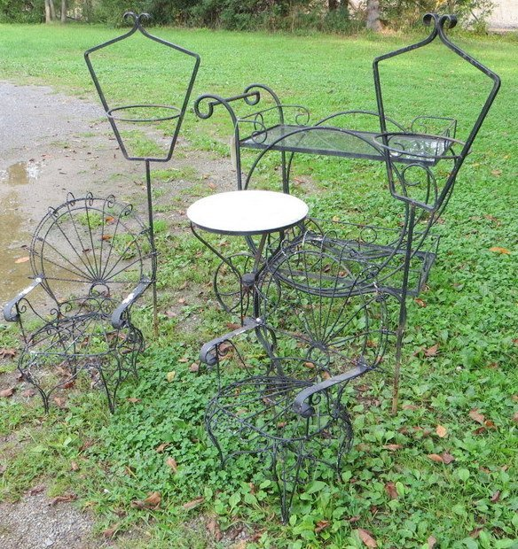 7: Six outdoor garden articles including wrought iron t