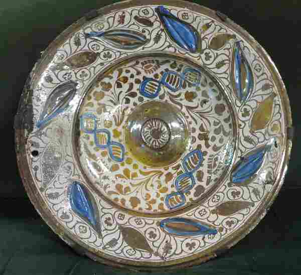 250: Tin glazed Hispano-Moresque Copper-lustre charger,