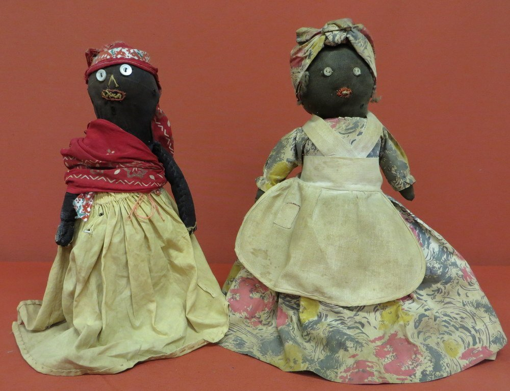 2: Two early black folk art bottle dolls in original co
