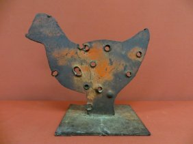 11: Chicken form cast iron shooting target with bullet
