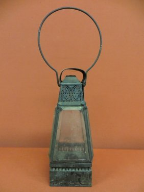 17: Early pierced tin candle lantern with beveled glass