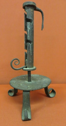 18: Early adjustable courting candle holder with turned