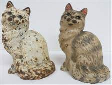 222 Two cast iron Hubley door stops of seated cats on