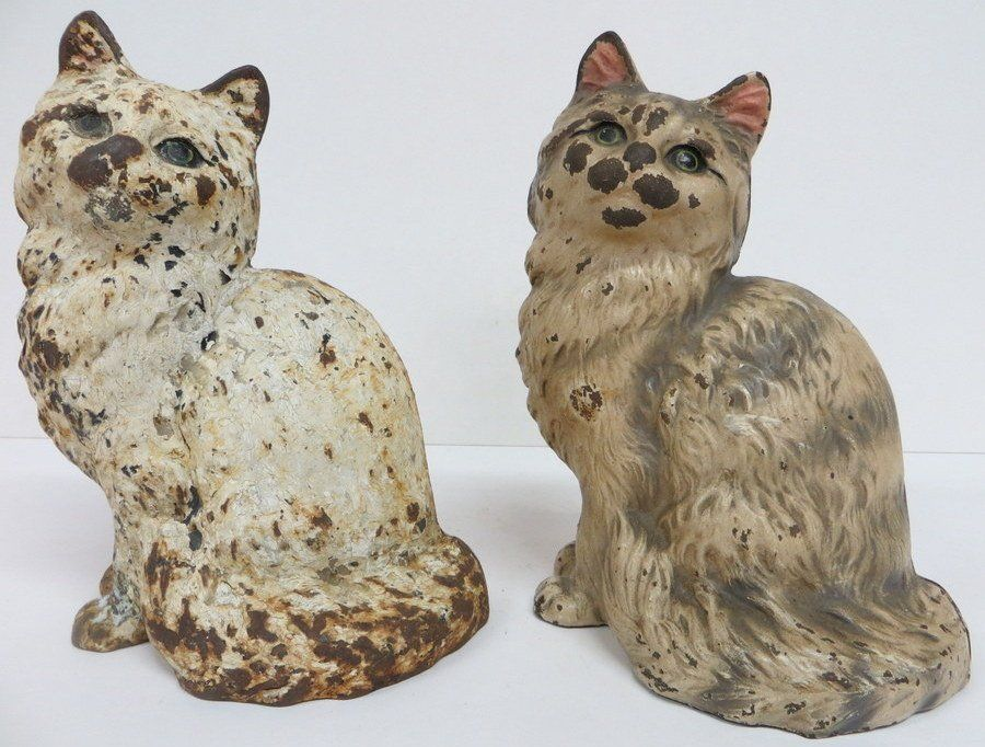 222: Two cast iron Hubley door stops of seated cats, on