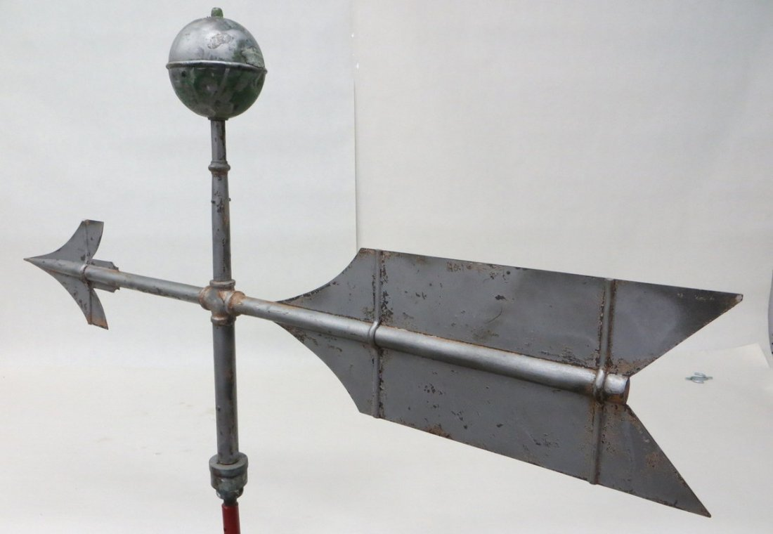 8: Old metal arrow weathervane constructed of tin, bras