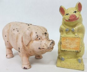 11: Two cast iron pig still banks, late 19th to early 2