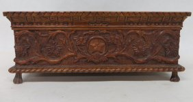 22: Heavily carved document box with flowers and vines