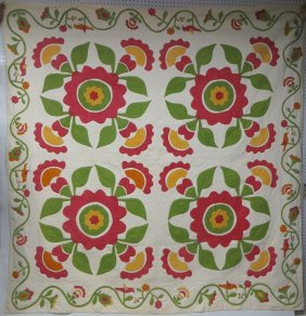 377: Appliqué quilt with green and yellow floral border