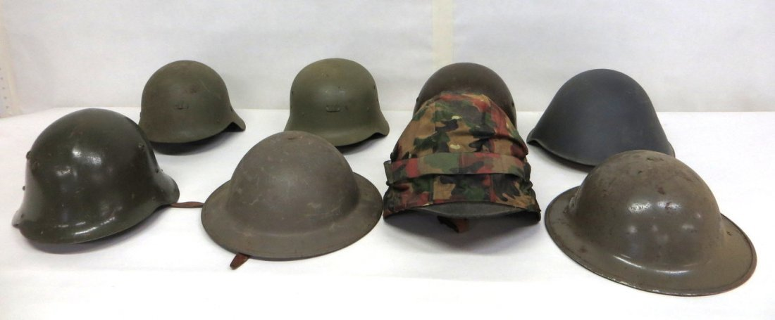 Collection of 8 military helmets, most appear to be lat