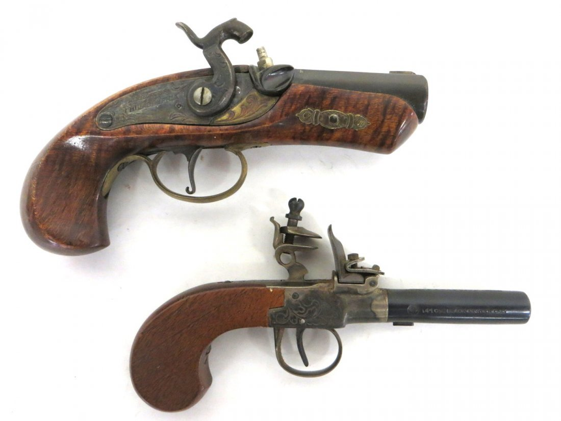 Two modern derringers, one black powder signed Phila. t
