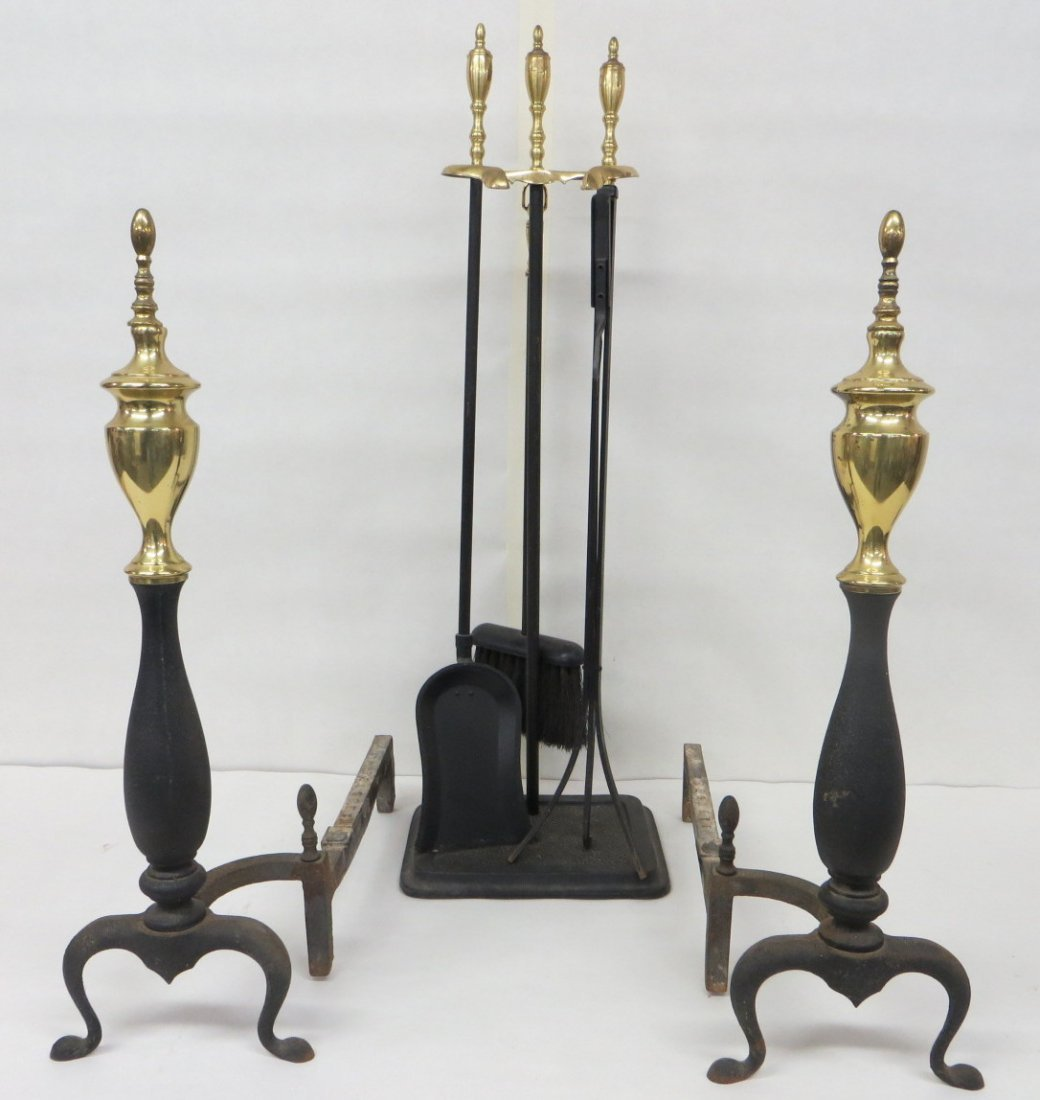 Pair of Chippendale style brass and iron andirons and m